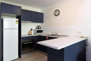 A kitchen or kitchenette at Coral Sea Villas