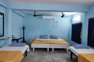 A bed or beds in a room at Galaxy Homestay
