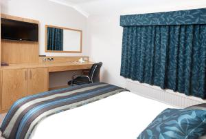 A bed or beds in a room at Warwick Conferences - Scarman