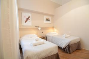 A bed or beds in a room at Melarancio 3 - Keys Of Florence