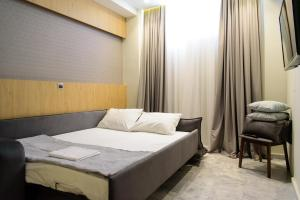 A bed or beds in a room at Eva Apartments