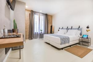 A bed or beds in a room at Casa Lirio