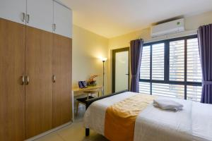 A bed or beds in a room at Aspire Saigon