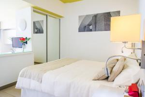 Voodi või voodid majutusasutuse Aparthotel Udalla Park toas