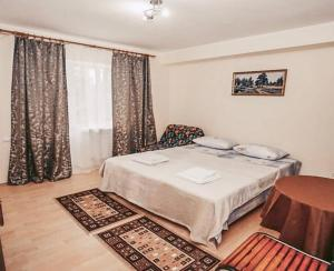 Кровать или кровати в номере Гостиница Алеандр