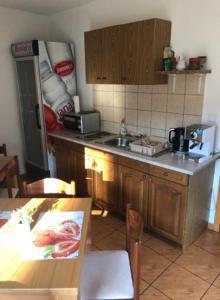 Kuchyň nebo kuchyňský kout v ubytování House Krizmanić