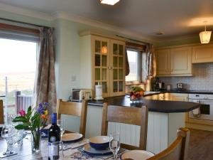 A kitchen or kitchenette at Ocean View Cottage