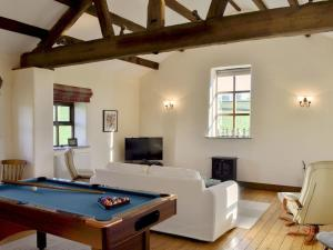 A pool table at The Barn