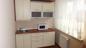 Кухня или мини-кухня в Отель Наталья