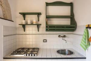 A kitchen or kitchenette at Villa Zottopera - Exclusive holiday