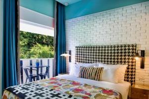 A bed or beds in a room at Center Chic Hotel - an Atlas Boutique Hotel