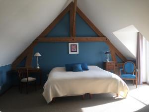 Un ou plusieurs lits dans un hébergement de l'établissement Haucourt du Temps