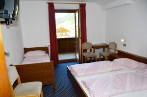 Ein Bett oder Betten in einem Zimmer der Unterkunft Pension Pichler