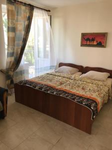 Кровать или кровати в номере Морская Чайка