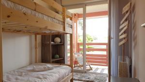 A bunk bed or bunk beds in a room at Apartment Cap Larros