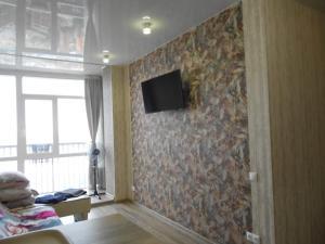 A television and/or entertainment center at Apartamenty na Tigrovoi 16A