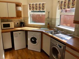A kitchen or kitchenette at Reading Budget Apartments