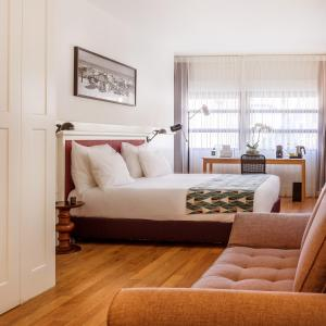 A bed or beds in a room at Lily & Bloom Boutique Hotel