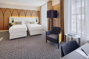 A bed or beds in a room at Hotel Nassau Breda, Autograph Collection