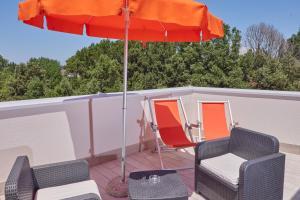 A balcony or terrace at Hotel Capo Circeo Wellness Spa