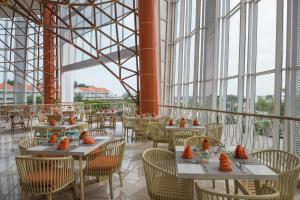 A restaurant or other place to eat at HARRIS Resort Barelang Batam