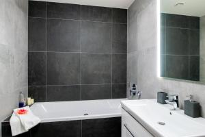 A bathroom at Cozy apartment with terrace