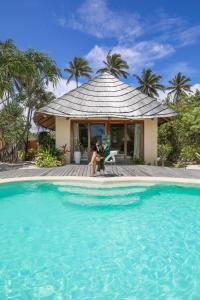 The swimming pool at or near Zanzibar White Sand Luxury Villas & Spa - Relais & Chateaux