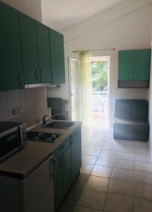 A kitchen or kitchenette at Guest House Bebic
