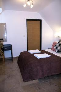 A bed or beds in a room at ATZ&H Inn