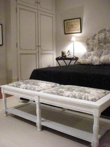 A bed or beds in a room at Le Mas Saint Florent