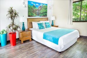 Cama o camas de una habitación en Tico Tico Villas - Adult Only