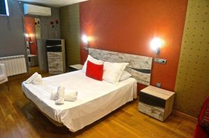A bed or beds in a room at Dúplex Palacio de Congresos - 2 baños