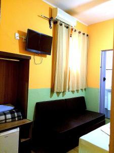A television and/or entertainment center at hotel Economico da SE