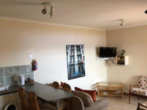 A television and/or entertainment center at Adagio Luxury Self Catering