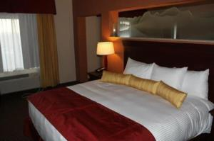 A bed or beds in a room at Wind River Hotel and Casino