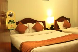 A bed or beds in a room at Samsara Boutique Hotel