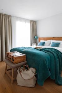 A bed or beds in a room at Luxus-Ostseeferienhaus Nehrung