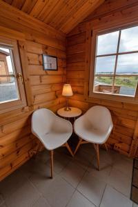 Ein Sitzbereich in der Unterkunft Dimmuborgir Guesthouse