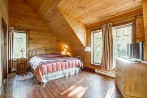 Un ou plusieurs lits dans un hébergement de l'établissement Le Village Windigo