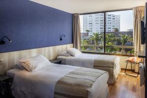 Cama o camas de una habitación en Hotel Club La Serena