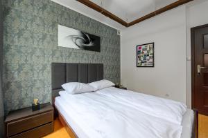 Postel nebo postele na pokoji v ubytování Oleander
