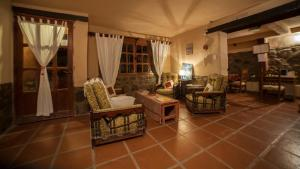 A seating area at Hostal Antigua Tilcara