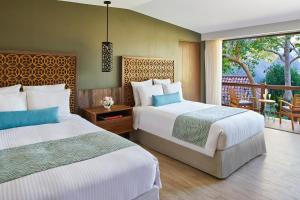 A bed or beds in a room at Secrets Papagayo All Inclusive - Adults Only