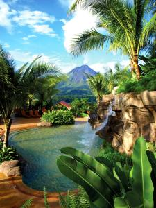 A garden outside The Springs Resort & Spa at Arenal