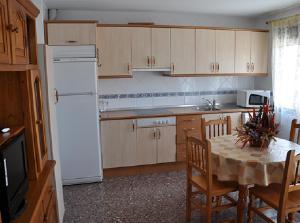 Una cocina o zona de cocina en Apartamentos Herranz