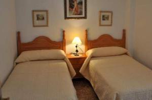 Cama o camas de una habitación en Apartamentos Herranz