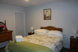 A bed or beds in a room at The Mackenzie Apartments