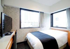 Giường trong phòng chung tại APA Hotel Tokyo Ojima