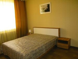 A bed or beds in a room at Apartments on Buinskiy 1