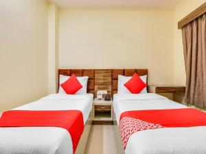 A bed or beds in a room at Samarth Inn